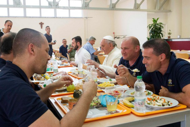 Pope Francis dines with Vatican workers in this July 2014 picture.