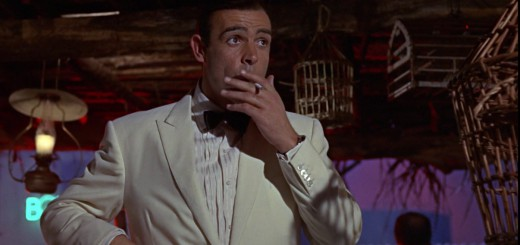 Goldfinger - Sean Connery as James Bond smoking