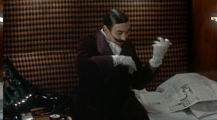 Finney as Poirot in a humorous private moment