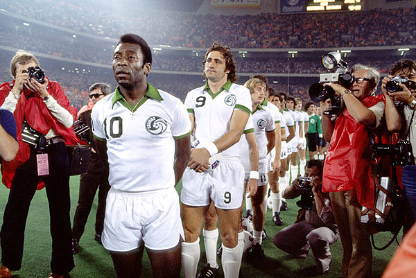 The Cosmos, led by Pelé, prepare for a game at a packed Giants Stadium