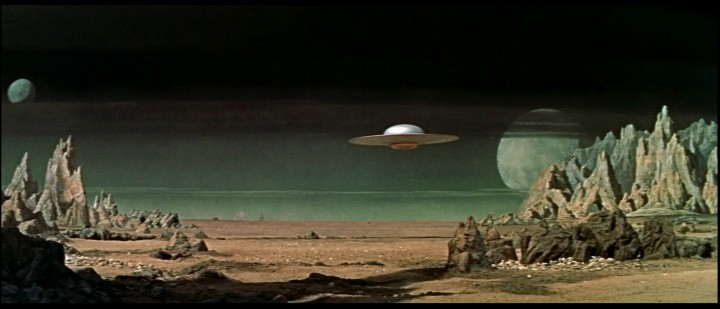 A wide matte painting and miniature spaceship in FORBIDDEN PLANET