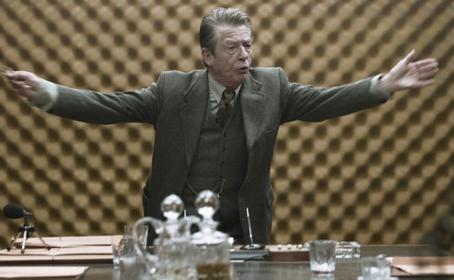 John Hurt as Control in the 2011 film against a delightfully retro backdrop